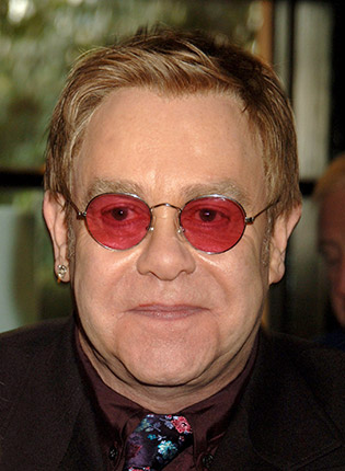 Elton John in pink sunglasses