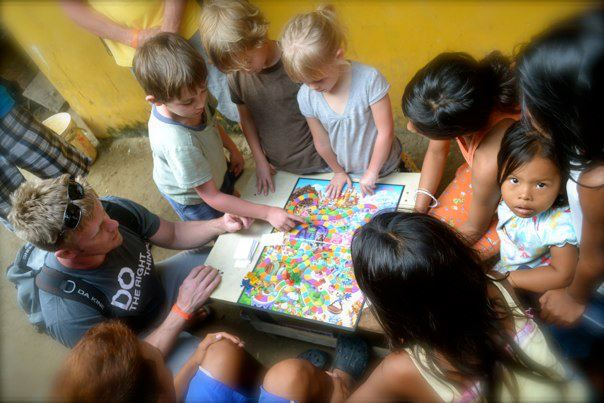 KLids playing Candy Land with a group of kids in the San Blas Islands