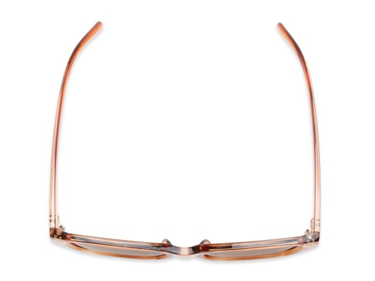 Overhead of Lucy in Clear Pink Frame with Amber Lenses